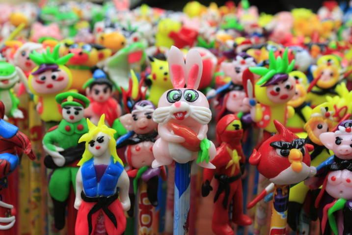 craftsman making toy figurine